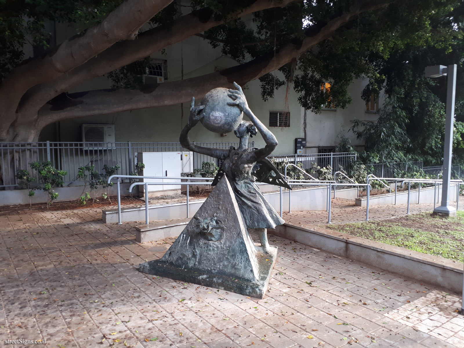 """Woman with Sphere and Pyramid"" - Outdoor sculpture by Bernard Reder - Mandelstamm St 5, Tel Aviv-Yafo, Israel"
